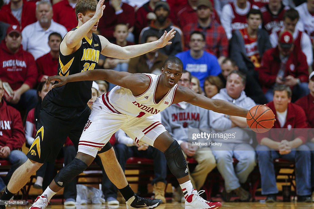 <a gi-track='captionPersonalityLinkClicked' href=/galleries/search?phrase=Noah+Vonleh&family=editorial&specificpeople=9612442 ng-click='$event.stopPropagation()'>Noah Vonleh</a> #1 of the Indiana Hoosiers stretches to pull in the ball as Adam Woodbury #34 of the Iowa Hawkeyes guards at Assembly Hall on February 27, 2014 in Bloomington, Indiana. Indiana defeated Iowa 93-86.