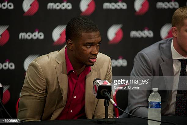 Noah Vonleh of the Portland Trail Blazers is introduced by GM Neil Oshay and head coach Terry Stotts during a press conference on June 29 2015 at the...