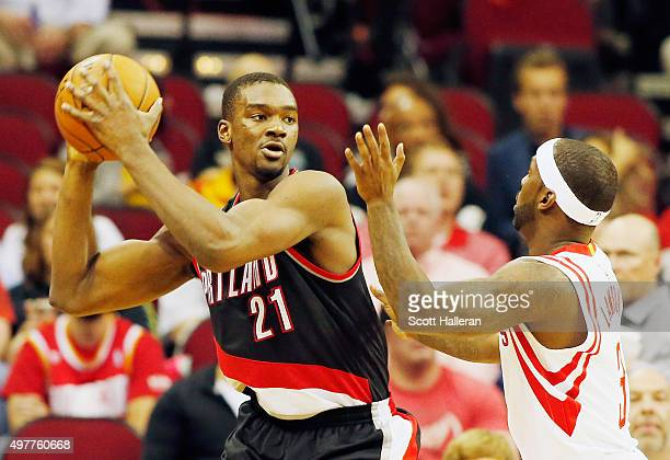Noah Vonleh of the Portland Trail Blazers looks to pass the basketball over Ty Lawson of the Houston Rockets during their game at the Toyota Center...