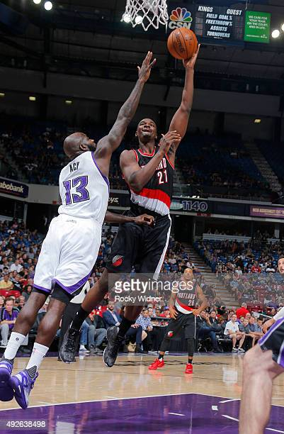 Noah Vonleh of the Portland Trail Blazers shoots against Quincy Acy of the Sacramento Kings on October 10 2015 at Sleep Train Arena in Sacramento...