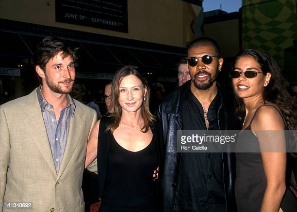 Noah Wyle and Tracy Warbin Eriq La Salle and girlfriend at the Premiere of 'Out of Sight' Cineplex Odeon Universal Studios Cinema Universal City