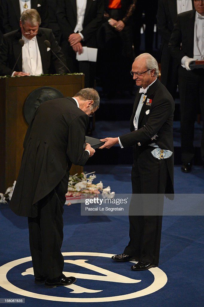 Nobel Laureate, professor Serge Haroche (L) of France bows as he receives his 2012 Nobel Prize for Physics from King Carl XVI Gustaf of Sweden during the Nobel Prize Ceremony at Concert Hall on December 10, 2012 in Stockholm, Sweden.