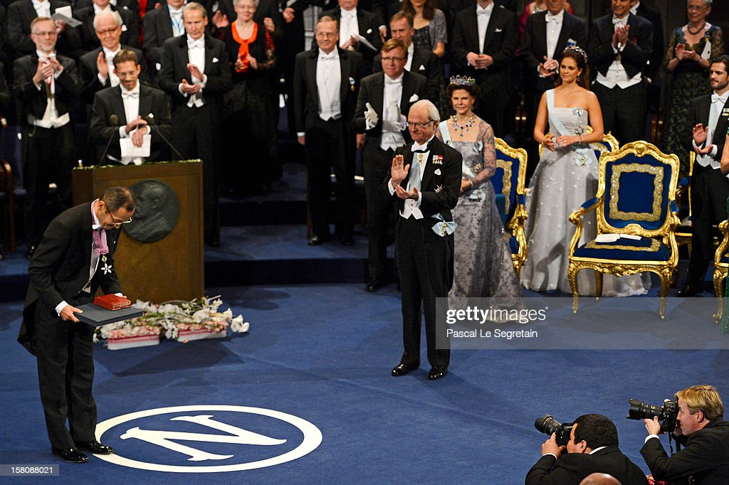Nobel Laureate, Professor Shinya Yamanaka (L) of Japan acknowledges the applause after receiving the 2012 Nobel Prize for Medicine from King Carl XVI Gustaf of Sweden (C) as Queen Silvia of Sweden, behind King Carl XVI Gustaf, and Princess Madeleine of Sweden, behind Queen Silivia, look on, during the 2012 Nobel Prize Award Ceremony at Concert Hall on December 10, 2012 in Stockholm, Sweden.