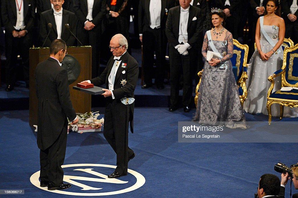 Nobel Laureate, Professor Shinya Yamanaka (L) of Japan receives the 2012 Nobel Prize for Medicine from King Carl XVI Gustaf of Sweden as Queen Silvia of Sweden (2nd R) and Princess Madeleine of Sweden (R) look on during the Nobel Prize Ceremony at Concert Hall on December 10, 2012 in Stockholm, Sweden.