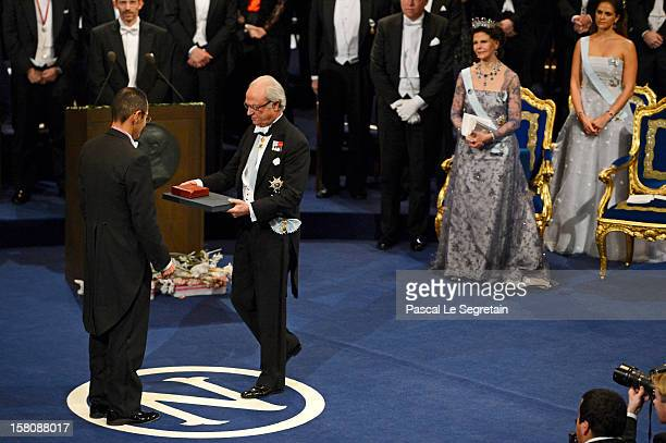 Nobel Laureate Professor Shinya Yamanaka of Japan receives the 2012 Nobel Prize for Medicine from King Carl XVI Gustaf of Sweden as Queen Silvia of...
