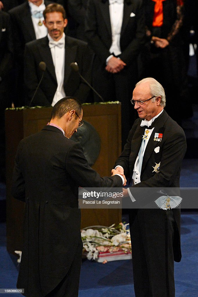 Nobel Laureate, Professor Shinya Yamanaka (L) of Japan receives the 2012 Nobel Prize for Medicine from King Carl XVI Gustaf of Sweden during the Nobel Prize Ceremony at Concert Hall on December 10, 2012 in Stockholm, Sweden.