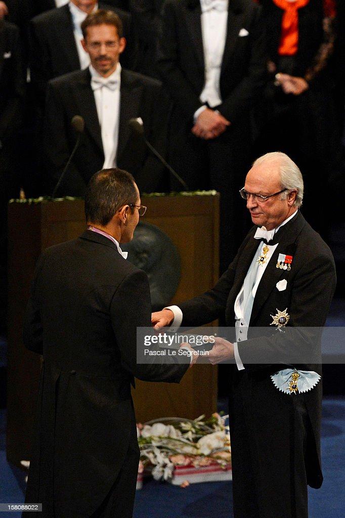 Nobel Laureate Professor Shinya Yamanaka of Japan receives the 2012 Nobel Prize for Medicine from King Carl XVI Gustaf of Sweden during the Nobel...