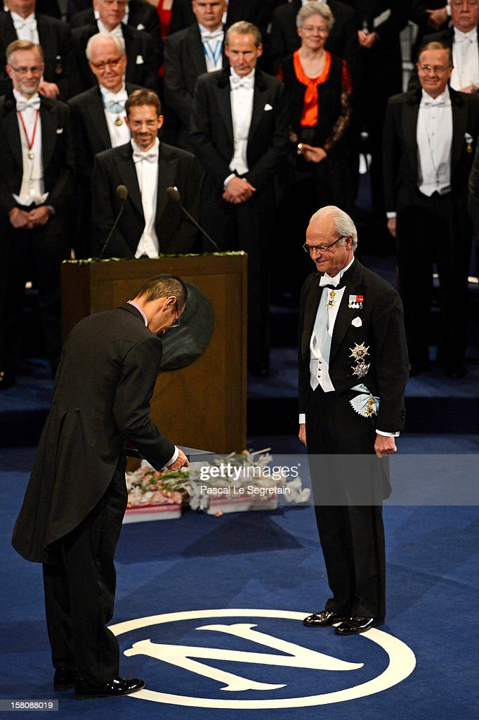 Nobel Laureate, Professor Shinya Yamanaka (L) of Japan takes a bow after receiving the 2012 Nobel Prize for Medicine from King Carl XVI Gustaf of Sweden during the Nobel Prize Ceremony at Concert Hall on December 10, 2012 in Stockholm, Sweden.
