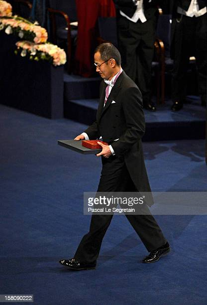 Nobel Laureate Professor Shinya Yamanaka of Japan walks to his seat after receiving hss Nobel Prize for Medicine from King Carl XVI Gustaf of Sweden...