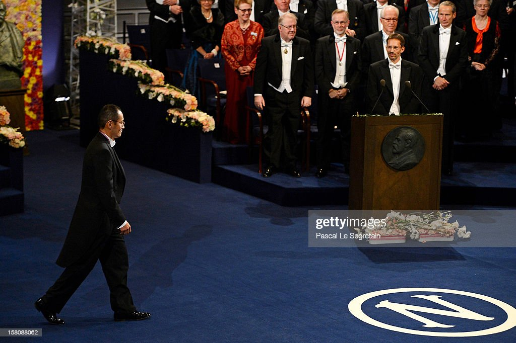 Nobel Laureate, Professor Shinya Yamanaka of Japan walks to the center of the stage to receive his Nobel Prize for Medicine from King Carl XVI Gustaf of Sweden during the 2012 Nobel Prize Award Ceremony during the Nobel Prize Ceremony at Concert Hall on December 10, 2012 in Stockholm, Sweden.