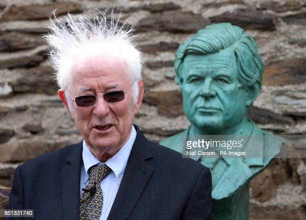 Nobel Laureate Seamus Heaney reads a peom in front of a bust of Senator Ted Kennedy unveiled at the Kennedy family homestead in Dunganstown Co...