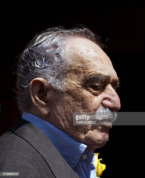 Nobel Literature prizewinning writer and journalist Colombian Gabriel Garcia Marquez gestures while coming out from his house to meet the press...