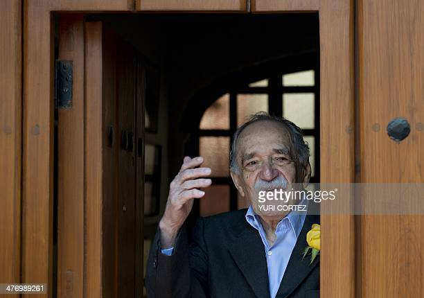 Nobel Literature prizewinning writer and journalist Colombian Gabriel Garcia Marquez waves while coming out from his house to meet the press during...