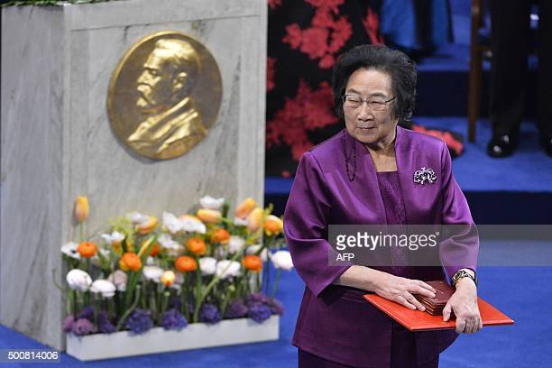 Nobel Medicine Prize 2015 cowinner Chinese Youyou Tu leaves the stage after receiving her medal during the 2015 Nobel prize award ceremony at the...