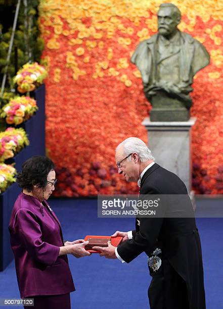 Nobel Medicine Prize 2015 cowinner Chinese Youyou Tu receives her medal from King of Sweden Carl XVI Gustaf during the 2015 Nobel prize award...