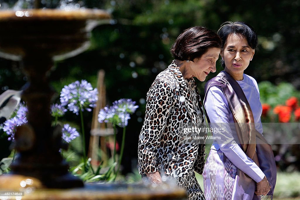 Nobel Peace Laureate and Myanmar opposition leader Aung San Suu Kyi walks with NSW Governor Marie Bashir in the gardens of Government House on November 27, 2013 in Sydney, Australia. Aung San Suu Kyi is in Australia for five days to discuss democratic reform in Myanmar. She will deliver a speech at the Sydney Opera House and visit Canberra and Melbourne during her stay.