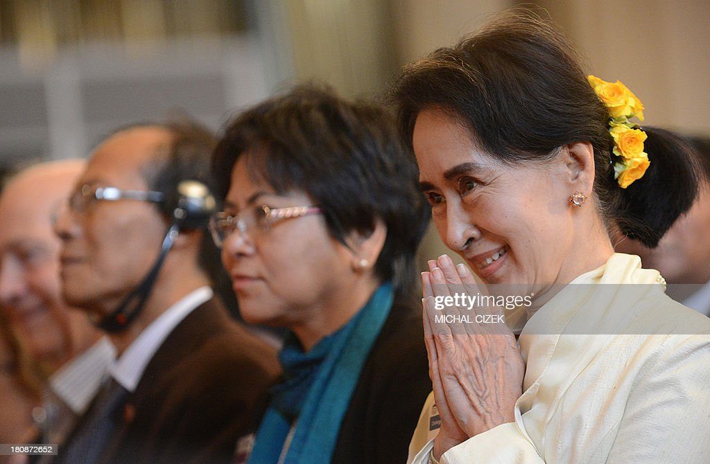 Nobel peace laureate and Myanmar pro-democracy icon Aung San Suu Kyi (R) greets at the 17th Forum 2000 Conference focusing on Societies and transition, on September 17, 2013, in Prague. The annual forum was launched by the late Czech Velvet Revolution icon Vaclav Havel and American Holocaust survivor Elie Wiesel in 1997. CIZEK