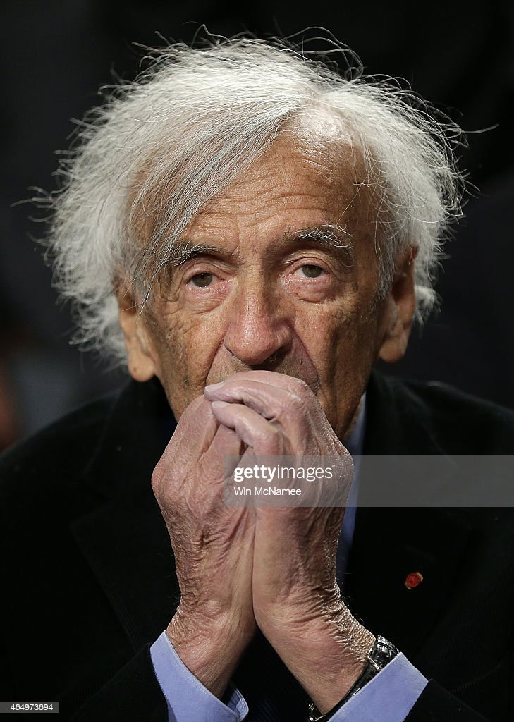 Nobel Peace Laureate Elie Wiesel warms his hands after arriving for a roundtable discussion on Capitol Hill March 2, 2015 in Washington, DC. Wiesel, Sen. Ted Cruz and Rabbi Scmuley Boteach participated in a discussion entitled 'The Meaning of Never Again: Guarding Against a Nuclear Iran.'