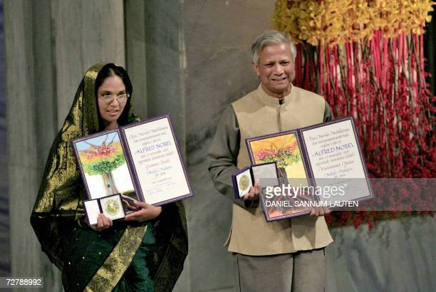 Nobel Peace laureate Muhammad Yunus and Grameen Bank represintative Mosammat Taslima Begum pose for a picture with the Nobel medal and diploma at...