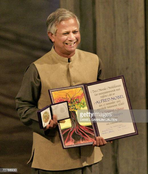Nobel Peace laureate Muhammad Yunus poses for a picture with the Nobel medal and diploma at Oslo Town Hall 10 December 2006 In receiving the Nobel...