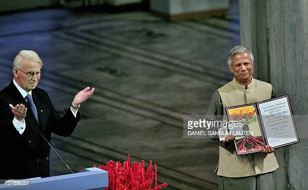 Nobel Peace laureate Muhammad Yunus receives from the chairman of the Norwegian Nobel PeacePrize Committee Ole Danbolt Mjoes the Nobel medal and...