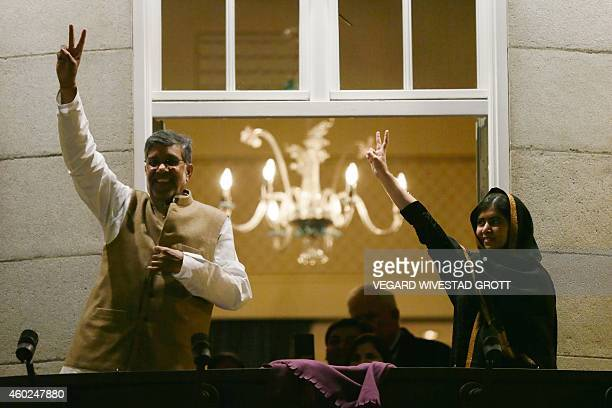 Nobel Peace Prize 2014 laureates Pakistan's Malala Yousafzai and India's Kailash Satyarthi wave to wellwishers from the balcony of the Grand Hotel...