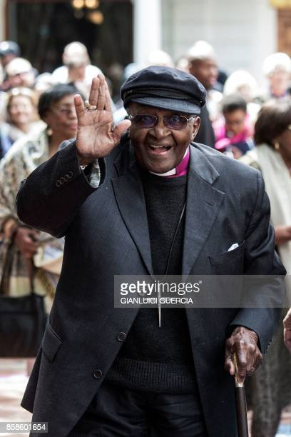 Nobel Peace Prize laureate and South African icon Archbishop Desmond Tutu reacts as he arrives to attend the unveiling ceremony of the 'Arch for the...