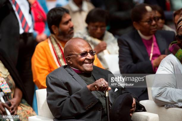 Nobel Peace Prize laureate and South African icon Archbishop Desmond Tutu reacts as he attends the unveiling ceremony of the 'Arch for the Arch' as...