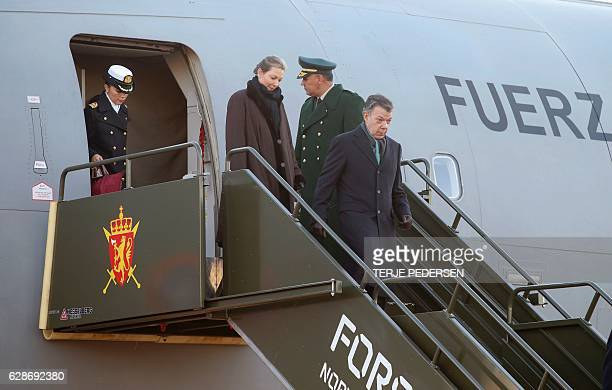 Nobel Peace prize laureate Colombian President Juan Manuel Santos and his wife Maria Clemencia Rodriguez arrive at Oslo airport on December 9 2016...