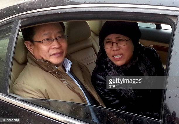 Nobel Peace Prize laureate Liu Xiaobo's wife Liu Xia together with human rights lawyer Mo Shaoping arrive at the court for the trial of her brother...