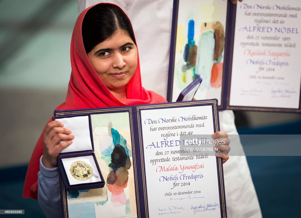 Nobel Peace Prize laureate Malala Yousafzai displays her medal and diploma during the Nobel Peace Prize awards ceremony at the City Hall in Oslo, Norway, on December 10, 2014. 17-year-old Pakistani girls' education activist Malala Yousafzai known as Malala shares the 2014 peace prize with the Indian campaigner Kailash Satyarthi, 60, who has fought for 35 years to free thousands of children from virtual slave labour.