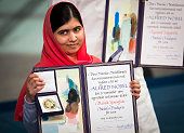 Nobel Peace Prize laureate Malala Yousafzai displays her medal and diploma during the Nobel Peace Prize awards ceremony at the City Hall in Oslo...