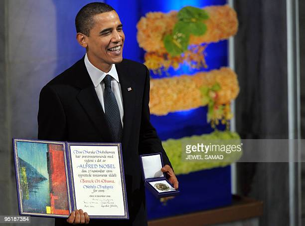 Nobel Peace Prize laureate US President Barack Obama smiles on the podium with his diploma and gold medal during the Nobel ceremony at the City Hall...
