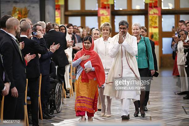 Nobel Peace Prize laureates Kailash Satyarthi and Malala Yousafzai arrive for the Nobel Peace Prize awards ceremony at the City Hall in Oslo Norway...