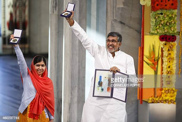 Nobel Peace Prize laureates Kailash Satyarthi and Malala Yousafzai display their medals and diplomas during the Nobel Peace Prize awards ceremony at...