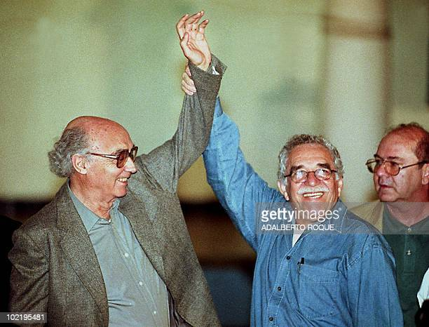 Nobel Prize for Literature winner from Colombia Gabriel Garcia Marquez raises the arm of another Nobel literature laureate Jose Saramago of Portugal...