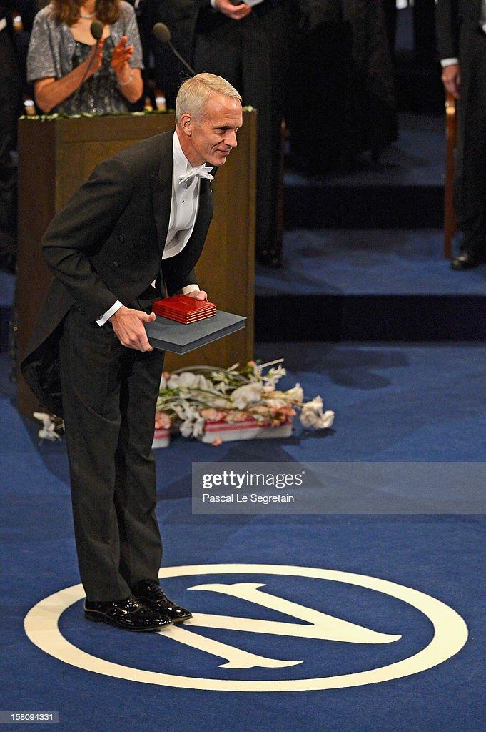 Nobel Prize in Chemistry laureate Professor Brian K. Kobilka of the USA reacts after receiving his Nobel Prize from King Carl XVI Gustaf of Sweden during the 2012 Nobel Prize Award Ceremony during the Nobel Prize Ceremony at Concert Hall on December 10, 2012 in Stockholm, Sweden.