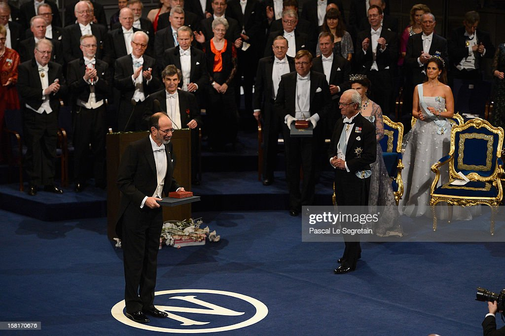 Nobel Prize in Economic Sciences laureates Professor Alvin E. Roth of the USA (L) acknowledges applause after receiving his Nobel Prize from King <a gi-track='captionPersonalityLinkClicked' href=/galleries/search?phrase=Carl+XVI+Gustaf&family=editorial&specificpeople=159449 ng-click='$event.stopPropagation()'>Carl XVI Gustaf</a> of Sweden (3rd R), as Queen Silvia of Sweden (2nd R) and Princess Madeleine of Sweden (R) look on, during the Nobel Prize Ceremony at Concert Hall on December 10, 2012 in Stockholm, Sweden.