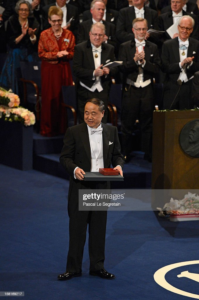 Nobel Prize in Literature laureate, author <a gi-track='captionPersonalityLinkClicked' href=/galleries/search?phrase=Mo+Yan&family=editorial&specificpeople=3971964 ng-click='$event.stopPropagation()'>Mo Yan</a> of China poses after receiving his Nobel Prize from King Carl XVI Gustaf of Sweden (R) during the Nobel Prize Ceremony at Concert Hall on December 10, 2012 in Stockholm, Sweden.