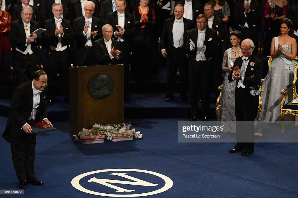 Nobel Prize in Literature laureate, author Mo Yan of China (L) reats after he received his Nobel Prize from King Carl XVI Gustaf of Sweden (2nd R) during the Nobel Prize Ceremony at Concert Hall on December 10, 2012 in Stockholm, Sweden.