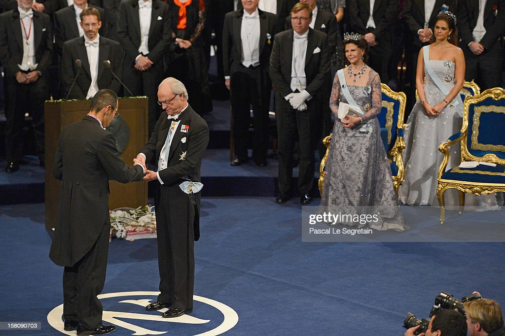 Nobel Prize in Medicine laureate Professor Shinya Yamanaka of Japan (L) receives his Nobel Prize from King Carl XVI Gustaf of Sweden (C) as Queen Silvia of Sweden (2nd R) and Princess Madeleine of Sweden (R) look on during the Nobel Prize Ceremony at Concert Hall on December 10, 2012 in Stockholm, Sweden.