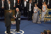 Nobel Prize in Medicine laureate Professor Shinya Yamanaka of Japan receives his Nobel Prize from King Carl XVI Gustaf of Sweden as Queen Silvia of...