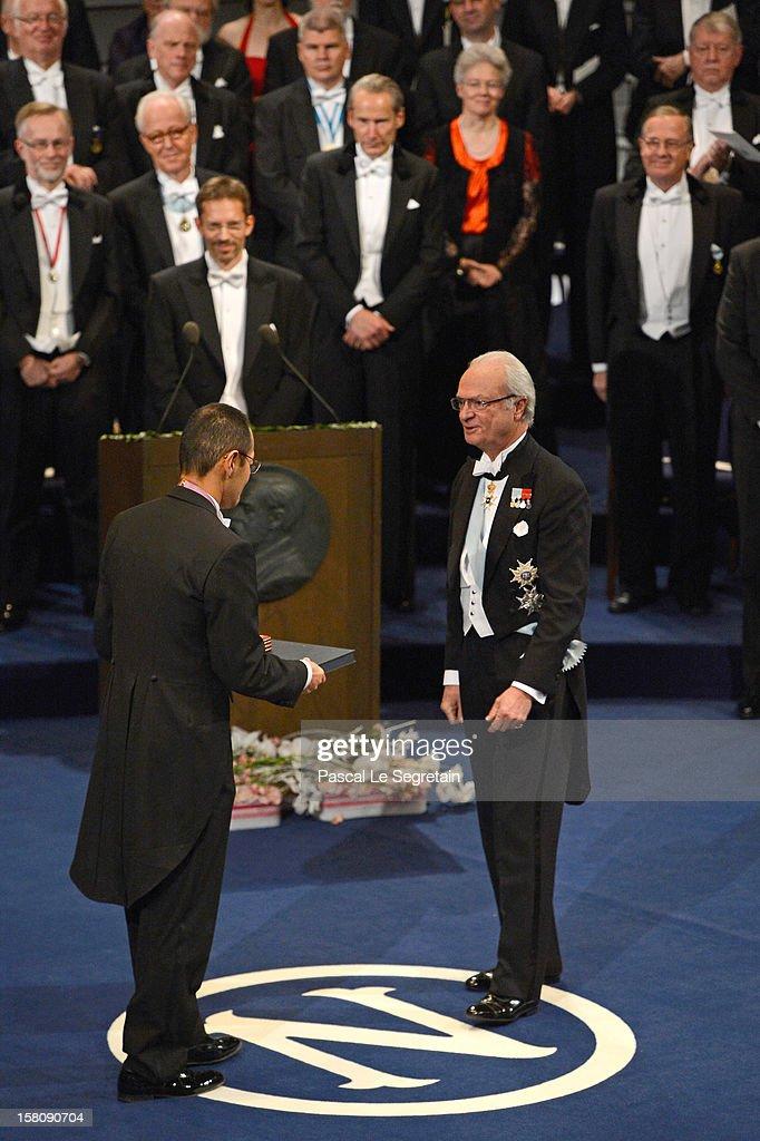 Nobel Prize in Medicine laureate Professor Shinya Yamanaka of Japan (L) receives his Nobel Prize from King Carl XVI Gustaf of Sweden during the Nobel Prize Ceremony at Concert Hall on December 10, 2012 in Stockholm, Sweden.
