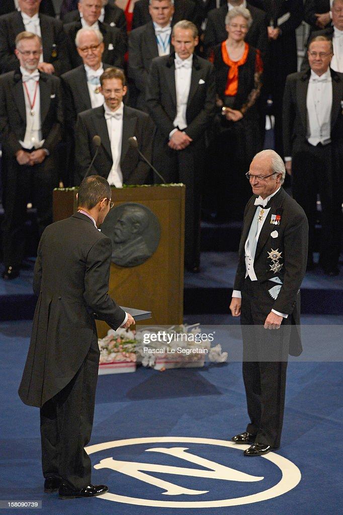 Nobel Prize in Medicine laureate Professor Shinya Yamanaka of Japan receives his Nobel Prize from King Carl XVI Gustaf of Sweden during the Nobel...