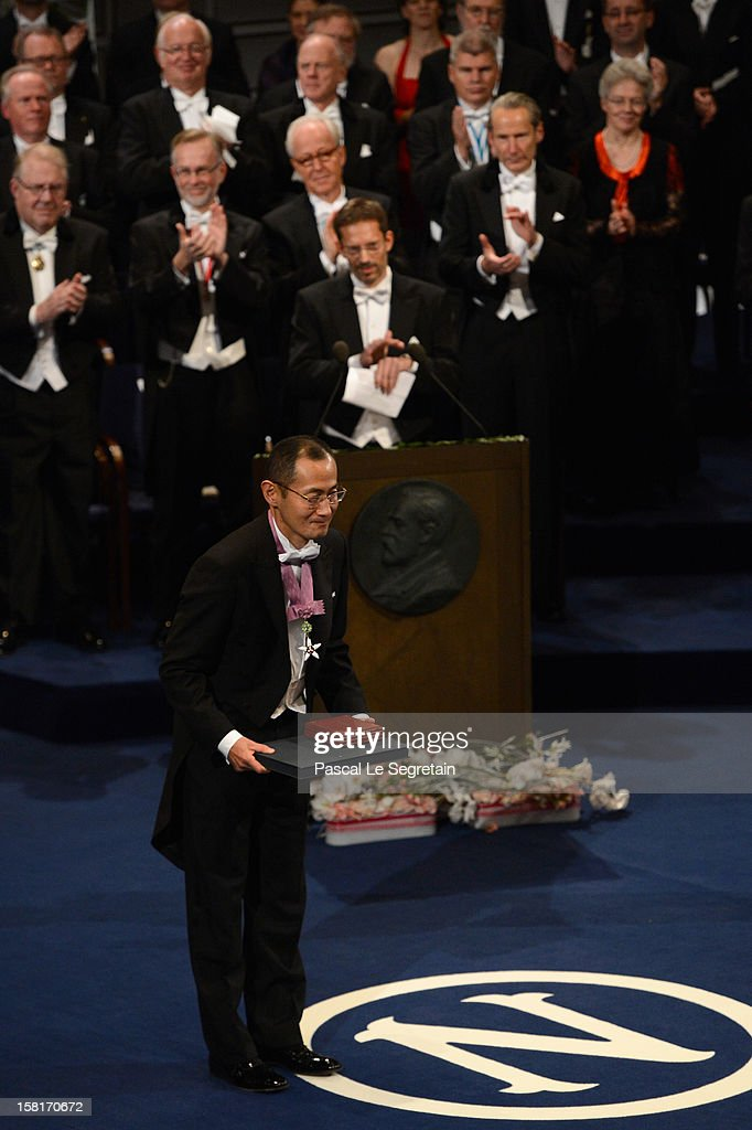 Nobel Prize in Medicine laureate Professor <a gi-track='captionPersonalityLinkClicked' href=/galleries/search?phrase=Shinya+Yamanaka&family=editorial&specificpeople=4810477 ng-click='$event.stopPropagation()'>Shinya Yamanaka</a> of Japan reacts after he received his Nobel Prize from King Carl XVI Gustaf of Sweden during the Nobel Prize Ceremony at Concert Hall on December 10, 2012 in Stockholm, Sweden.