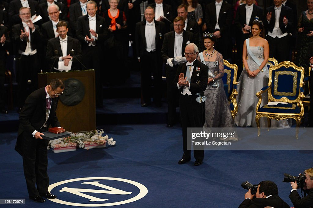 Nobel Prize in Medicine laureate Professor Shinya Yamanaka of Japan (L) reacts after he received his Nobel Prize from King Carl XVI Gustaf of Sweden during the Nobel Prize Ceremony at Concert Hall on December 10, 2012 in Stockholm, Sweden.
