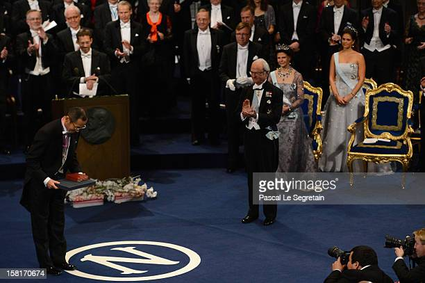 Nobel Prize in Medicine laureate Professor Shinya Yamanaka of Japan reacts after he received his Nobel Prize from King Carl XVI Gustaf of Sweden...