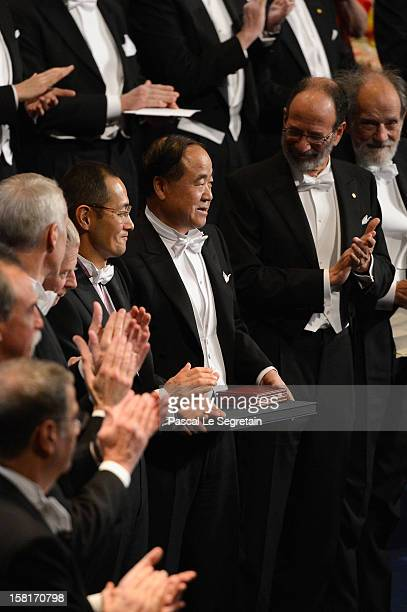 Nobel Prize in Medicine laureate Professor Shinya Yamanaka of Japan and Nobel Prize in Literature laureate author Mo Yan of China attend the 2012...