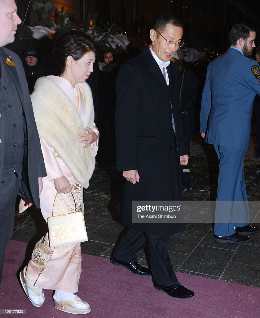 Nobel Prize in Medicine laureate Shinya Yamanaka (R) and his wife Chika are seen on departure for the award ceremony on December 10, 2012 in Stockholm, Sweden.