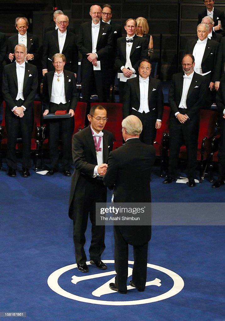 Nobel Prize in Medicine laureate Shinya Yamanaka receives the Nobel Prize from King Carl XVI Gustaf of Sweden during the Nobel Prize Award Ceremony at Concert Hall on December 10, 2012 in Stockholm, Sweden.